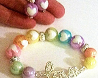 """Pearlescent Inlaid Heart Beaded Bracelet with Rhinestone """"LOVE"""" embellishment  (matching hearing aid charms available at a bundle price)!"""