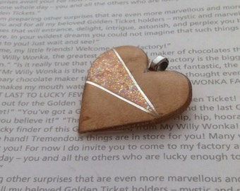 Beautiful wooden heart encased in resin with glitter accents, pendant