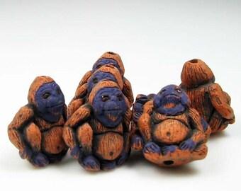 4 Tiny Orangatang Beads - CB472
