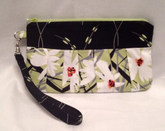 AK8- Compleat Clutch: in a wonderful flower print with pleated front, zipper closure and detatchable hand strap