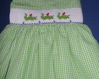 Hand smocked dress with alligators