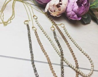 Long layering necklace on gold chain