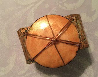 Copper with enameled disc