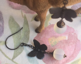 Ea-90 Black brass butterfly and frosted glass bead earrings.