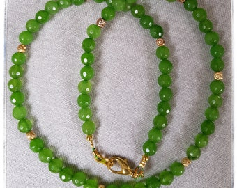 Faceted peridot beads with golden snails