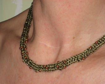 Knitted necklace made of pure silk with copper beads