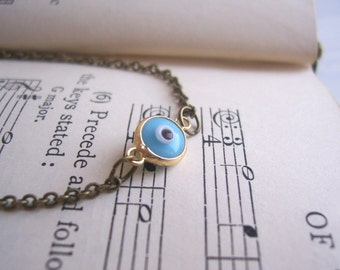 SALE Petite Evil Eye charm bracelet - sky blue protective small charm on golden brass - boho jewellery