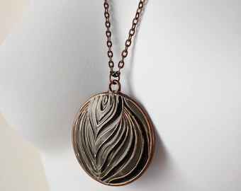 Black & Gray Circular Pendant Necklace on a copper-colored cable chain