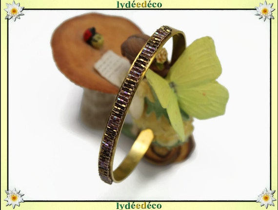 Bangle is 6mm amber and purple pastel woven glass beads and brass