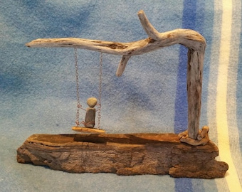 "Driftwood with rock person ""Enjoy """