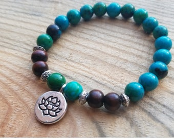 African turqoise and wood beaded strech bracelet with lotus charm
