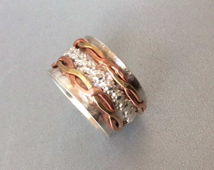 Sterling silver spinner ring withThree sweet spinners