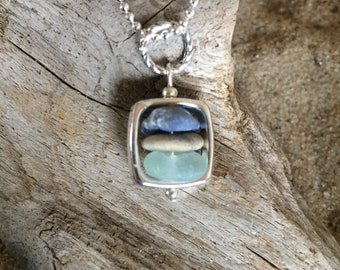Sea glass, beach stone, and Leland blue stone framed cairn necklace