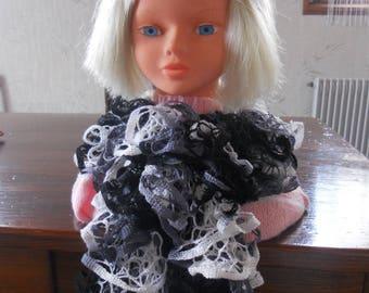 Ruffled scarf or pretty soft colors of black, white ruffle.