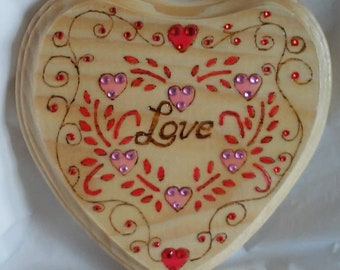 Love wood burned plaque, decorated with mini pink and red hearts and vines embellished with colored crystals
