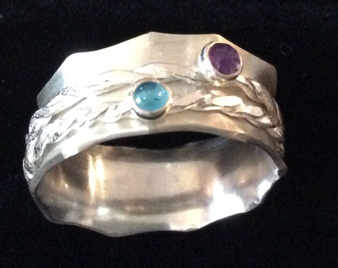 Sterling silver spinner ring with amethyst and blue apatite