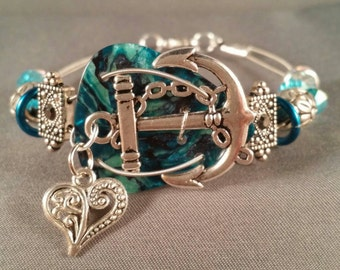 "Guitar pick and guitar string bracelet ""Love Teal Anchors"""