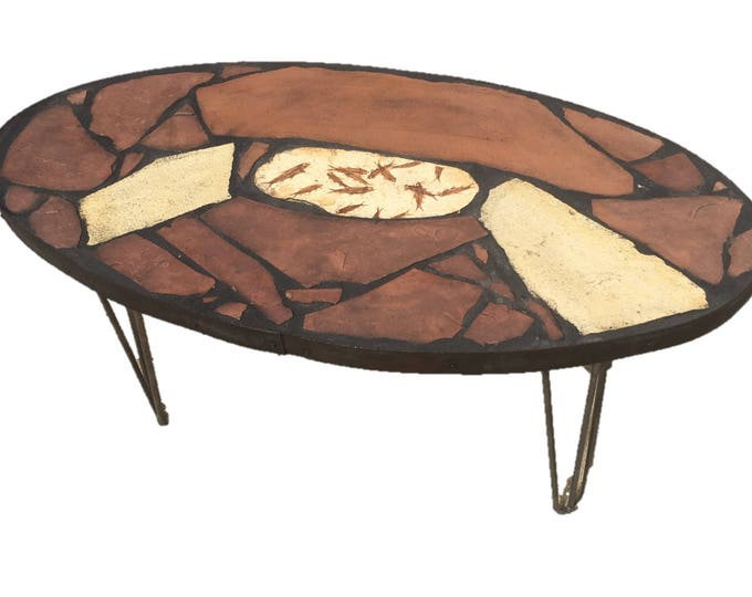 """Fishing Hole: A 40"""" x 20"""" x 18"""" tall fossil stone topped folk art table."""