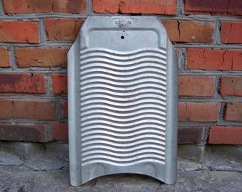 Vintage washboard. Soviet laundry room decor. Primitive washing board. Magnet board. USSR the 1950s Vintage metal washboard