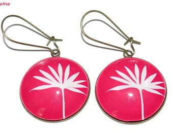 Bronze earrings with glass cabochons * foliage on a pink background *.