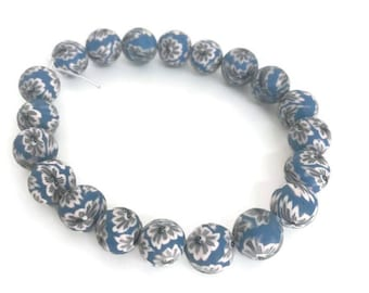 Polymer clay beads, blue and white, 7mm round beads, 20 bead strand.  White flowers.  Jewelry making. Beads for bracelet. Blue beads
