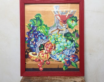 Charming French vintage water color still life painting in a red frame, fruit basket and wine carafe