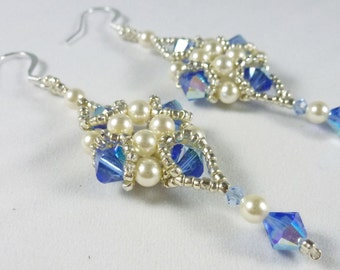 Swarovski crystal and pearl diamond dangling earrings.