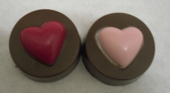 One dozen Heart topped Chocolate Covered Double Stuffed Oreos