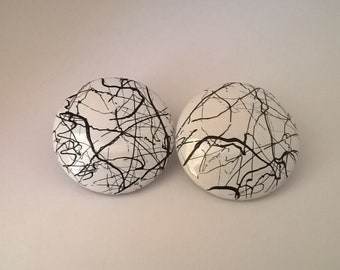Retro Vintage Large Button Earrings with Raised Black Streaks on White Background