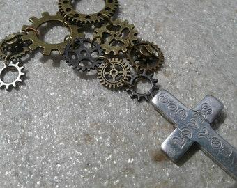 Burden of sin: metal gears, cross, and chain necklace