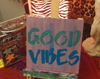 Good Vibes is a hand painted canvas done in shades of purples, blues, and greens. Positive thoughts and quotes just help make the day better