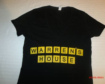 "Warren Haynes Shirt. ""Warren's House/Waffle House"" Mash up. This shirt comes on a Black ""Bella"" V-neck Ladies shirt."