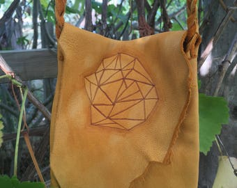 Raw edge leather cross body bag with burned geometric design