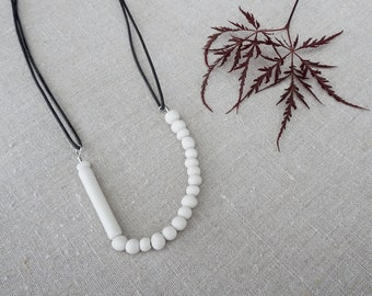 Ceramic necklace. Asymmetric. Handmade white porcelain beads. Jewelry for her