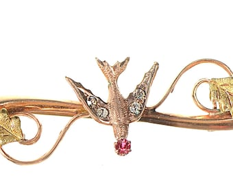 10k Victorian flying bird pin brooch with ruby and diamond paste stones