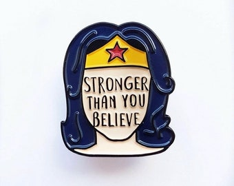 Stronger Than You Believe Soft enamel pin from UK guest artist Bookish and Bakewell.