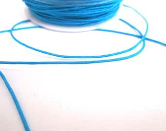 1 meter of 0.8 mm turquoise blue nylon thread