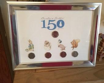Beatrix potter frame including coins