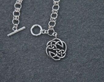 Silver Celtic Bracelet with Celtic Design Charm