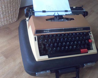 Typewriter, Portable, Achiever by Sears new ribbon , working typewriter, made in Japan