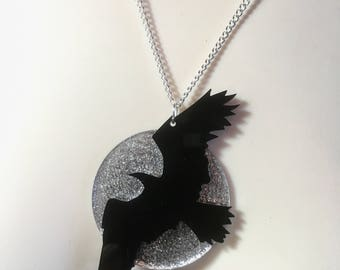 dramatic moon & flying crow laser cut acrylic necklace