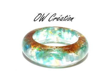 glitter and sand ring set in resin