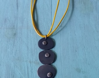 Black oxidized Sterling Silver pendant on yellow leather cord