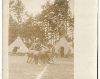 Military Camp with Soldiers Playing Field Sport with Tents in Background Vintage Real Photograph Postcard from 1900-1910 over 100 Years Old