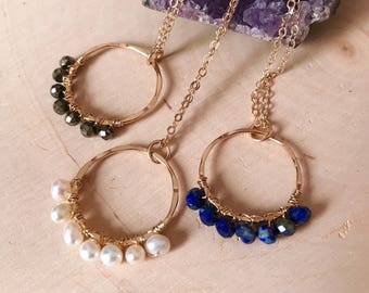 Gold Wire wrapped Pyrite Circle Pendant Necklace . - blue lapis - freshwater pearl - labradorite