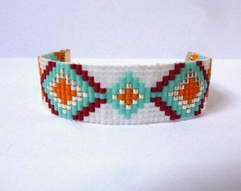 Turquoise, Burgundy and orange woven bracelet