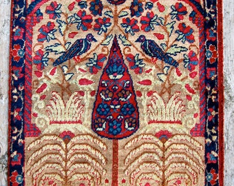pretty persian mat with birds and cypress tree.