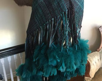 Hand spun hand dyed hand loomed shawl with ostrich feathers .