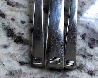 Airline utensils from US AIR or US Airways a now defunct airline a fork knife and spoon set likely from the 1990's