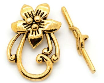 Gold metal flower shaped Toggle clasp. Size 30 x 20 mm.